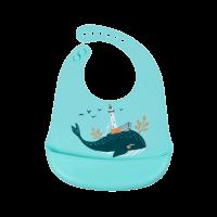 Śliniaczek silikonowy z kieszonką Wieloryb